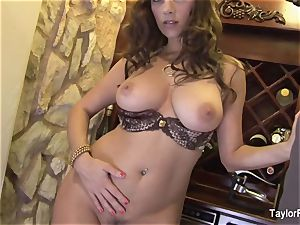 big-chested brown-haired Taylor Vixen taunts the camera