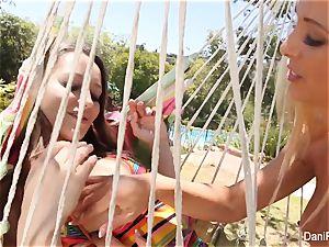 Dani and Cherie bang on the hammock
