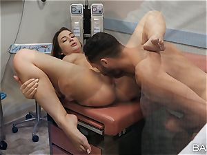 physician and nurse Blair Williams drill in clinic