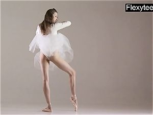 blond gymnast performs gymnastics