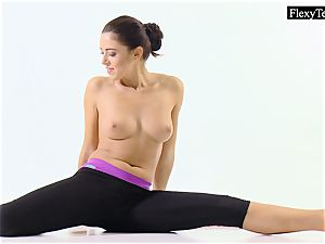 Tonya the red-hot gymnast makes astounding poses