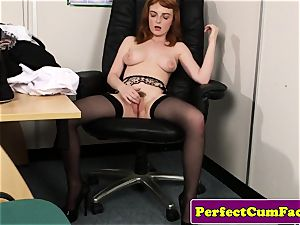 Stockinged red-haired facialized in office
