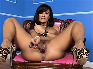 beautiful Lisa Ann sticks her dildo deep in her wet slit