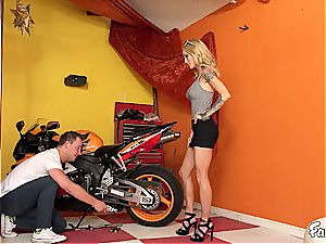 light-haired stepmom get's insatiable with her stepson in the garage