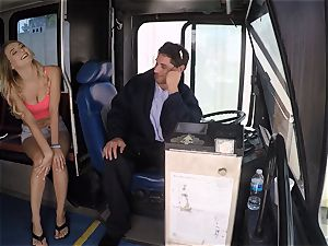Natalia Starr pokes a bus driver for a free ride