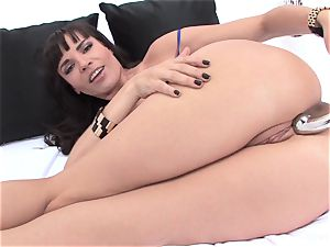 porn industry star Dana spreads her pink pucker with a large toy