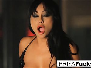 buxom Priya Rai rides the sybian at the strip club