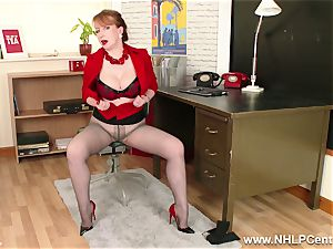 ginger-haired milf fingers labia on office desk in pantyhose